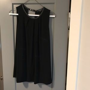 Black sleeveless blouse. Size L.